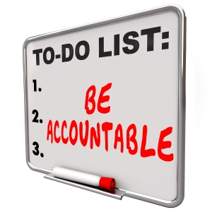 Be Accountable words on a to-do list dry erase board telling you